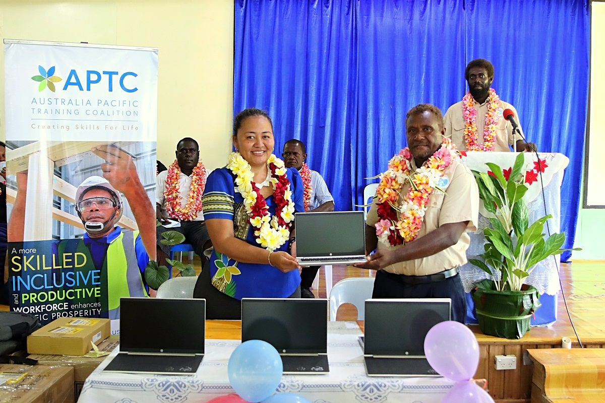APTC Country Director for Solomon Islands and Kiribati, Abigail Chang, presents laptops to Batuna Rural Training Centre Principal, Ibi Drelly, at the handover ceremony in the Western Province, Solomon Islands.