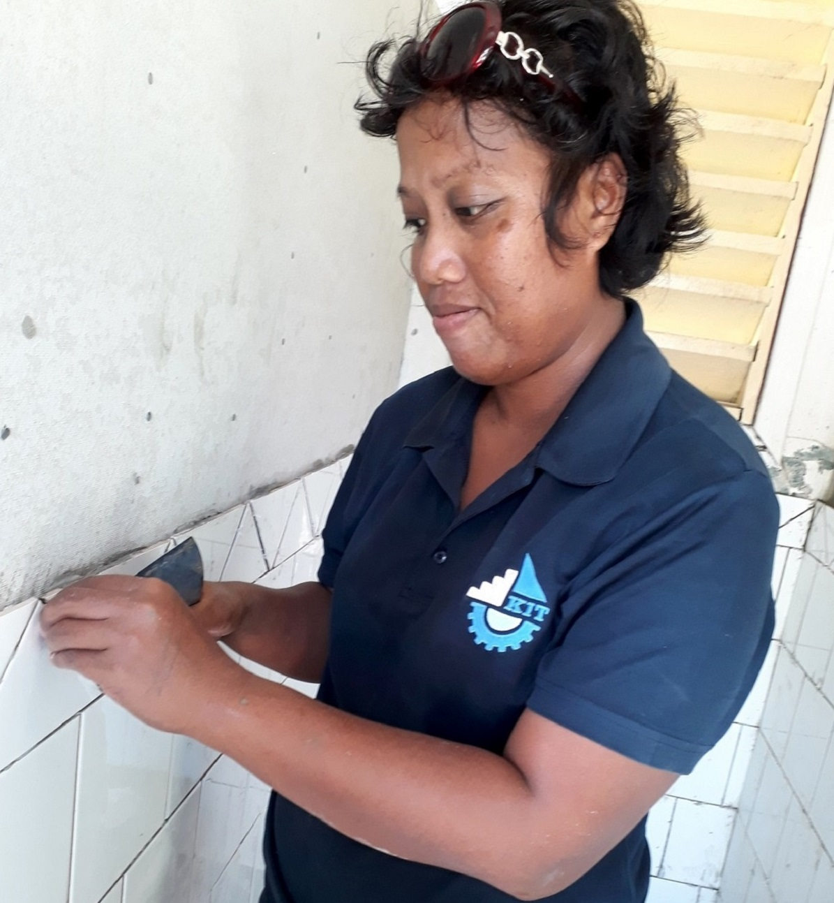 New beginning for i-Kiribati female tiling trainer